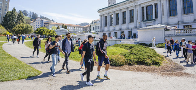 Students-walking-on-campus-750